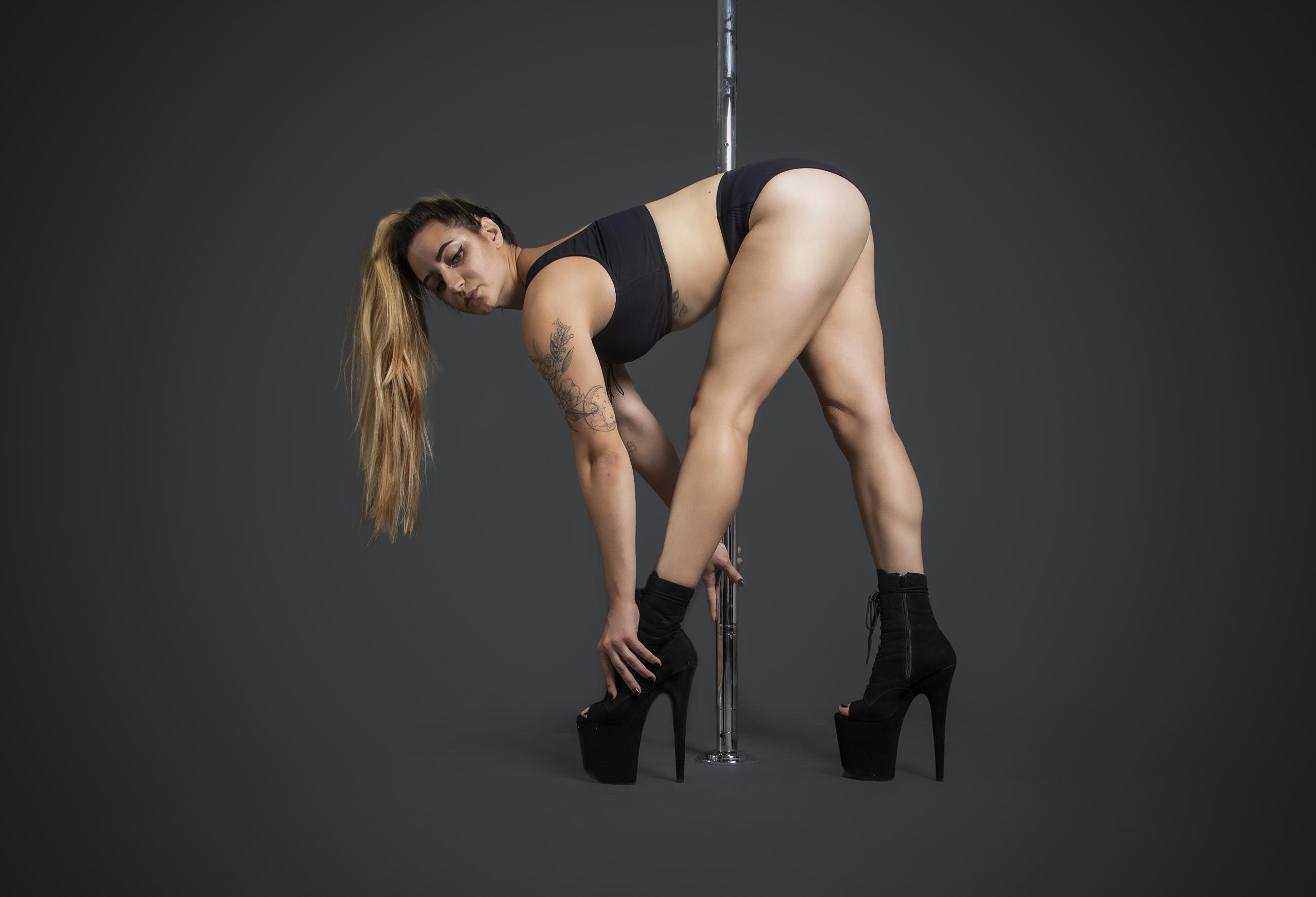 One woman holding a pose during a heels class at The Pole Hub