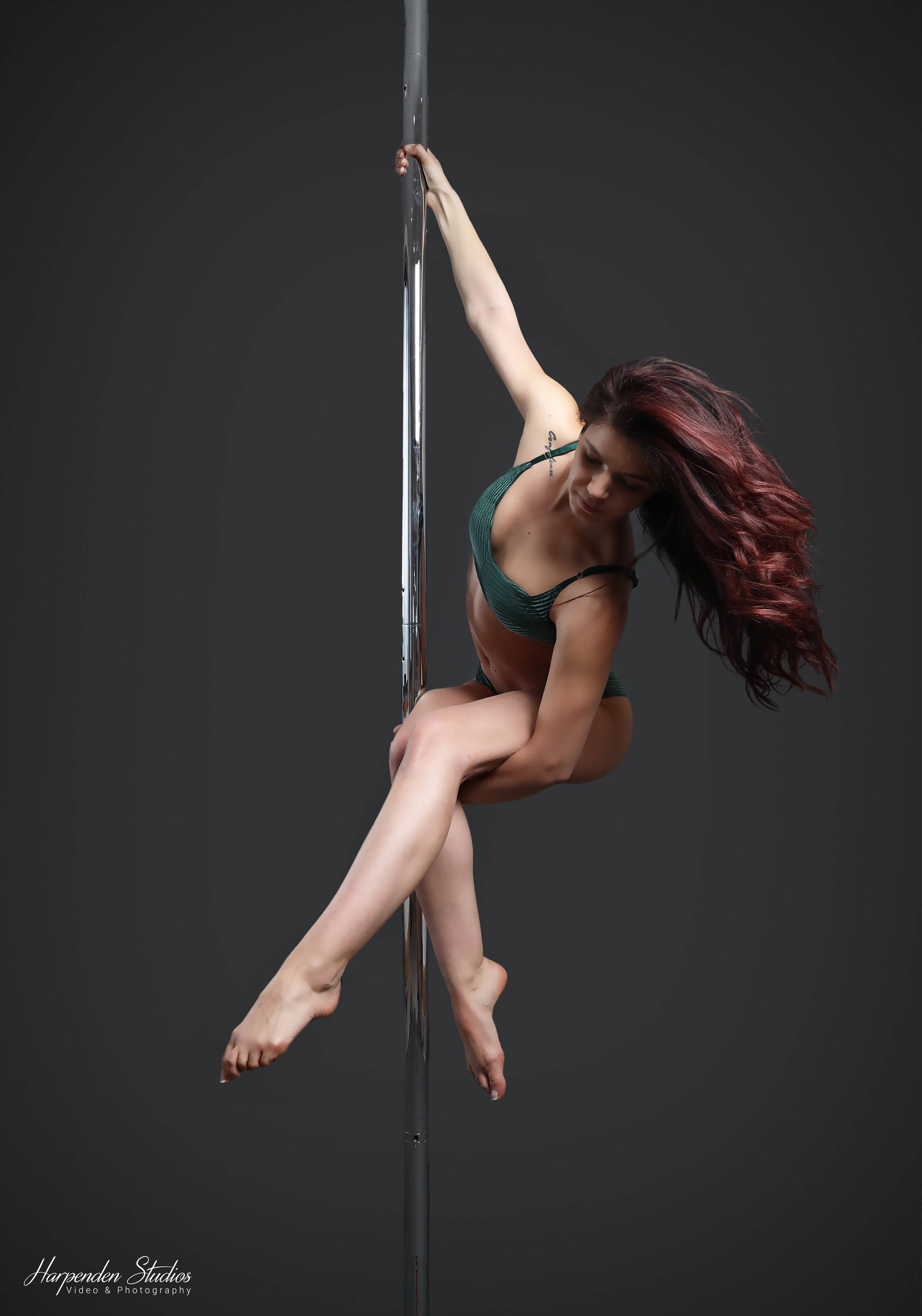 Instructor Martina holding a pose during a class at The Pole Hub